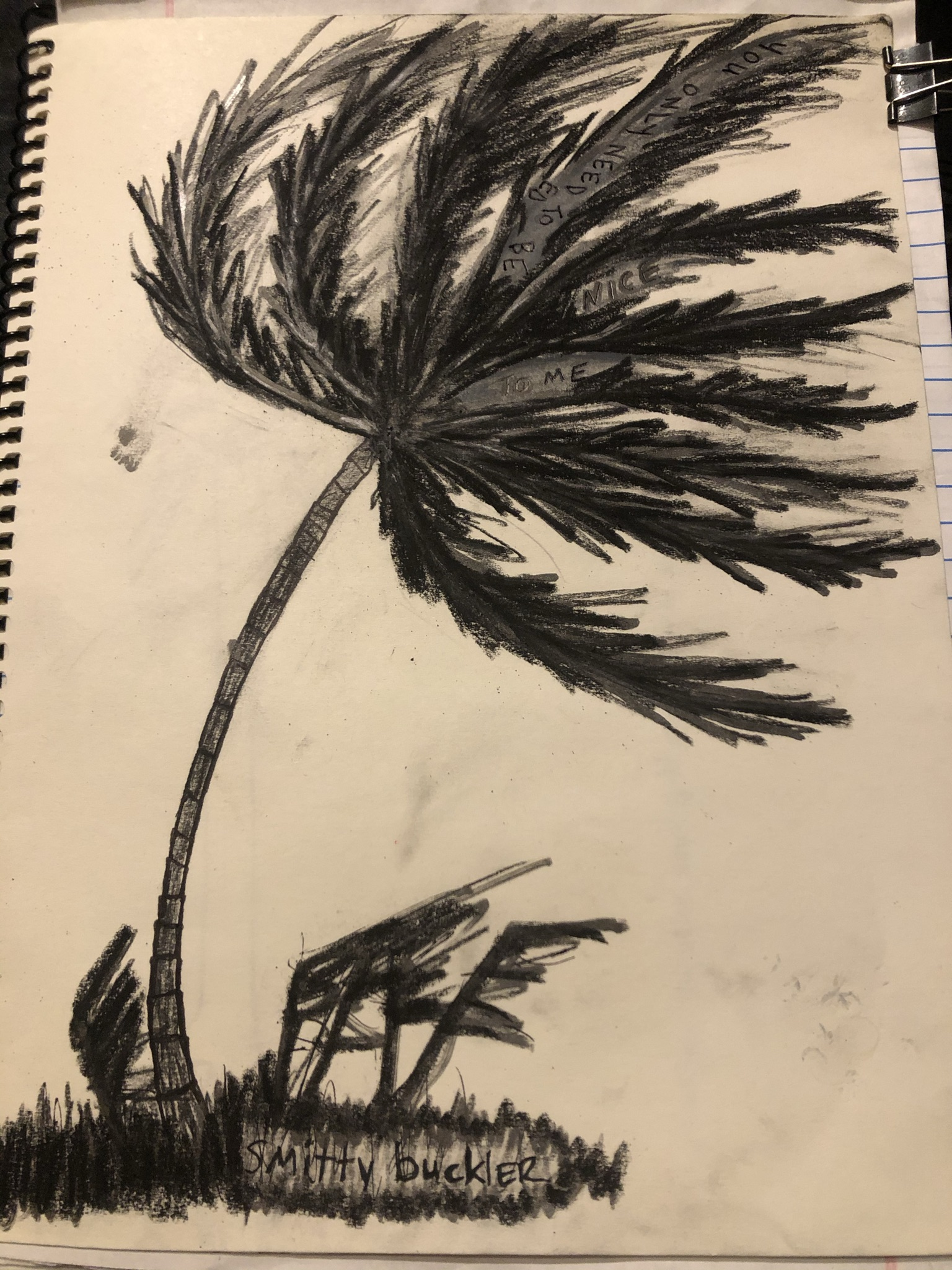 multimedia drawing of a palm tree blowing in the wind with words in the leaves